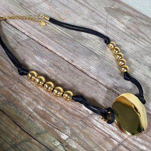 Robert Lee Morris modernist sand dollar necklace